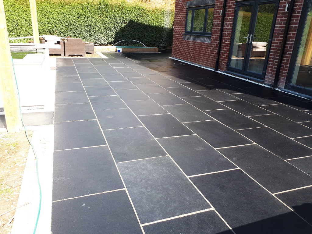 Acid Damaged Black Limestone Patio After Restoration Bromsgrove