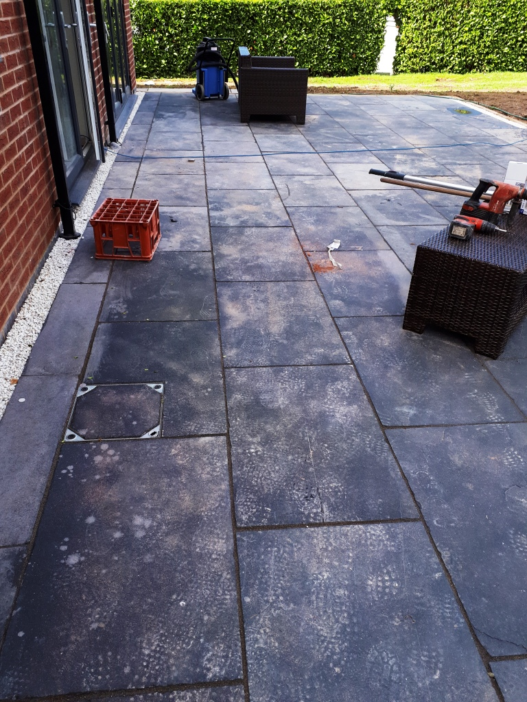 Acid Damaged Black Limestone Patio Before Restoration Bromsgrove