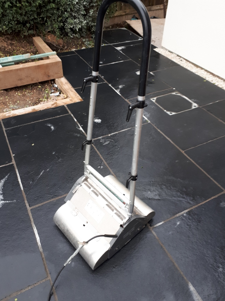 Acid Damaged Black Limestone Patio During Cleaning With CRB Machine Bromsgrove