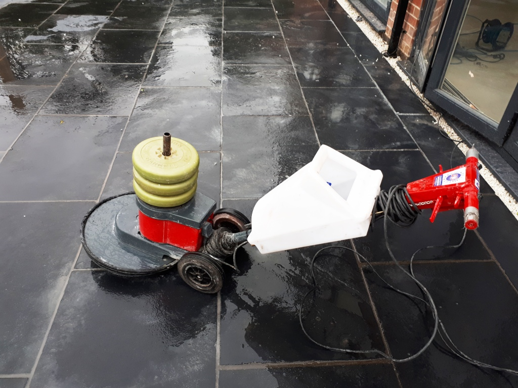 Acid Damaged Black Limestone Patio During Diamond Pad Polishing Bromsgrove